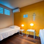 Chambre avec 2 lits simples 90 de l'appartement Lodge Coco Deshaies (Guadeloupe)