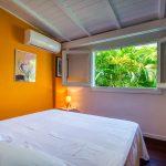 Chambre avec grand lit double 160 de l'appartement Lodge Coco Deshaies (Guadeloupe)
